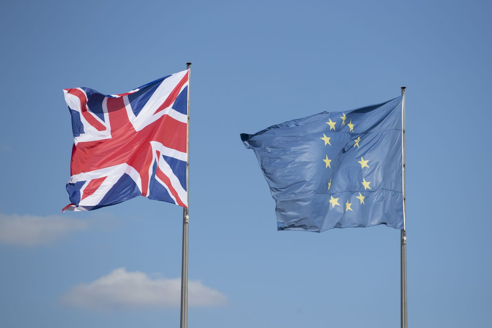 British Union and European Union flags fly side-by-side.
