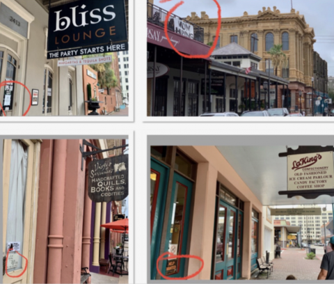 """Businesses in the Strand Historic District in Galveston, Texas advertise """"help wanted"""" and hiring signs."""
