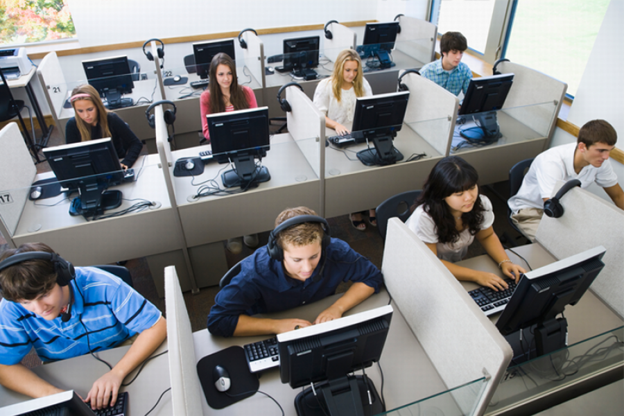 Students sitting at computers in a classroom