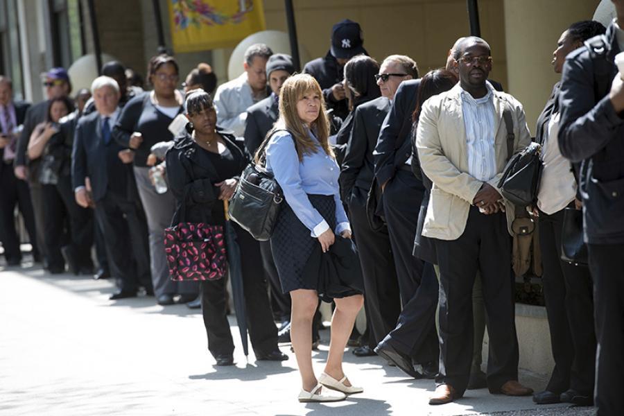 Job seekers line up outside a New York career fair.