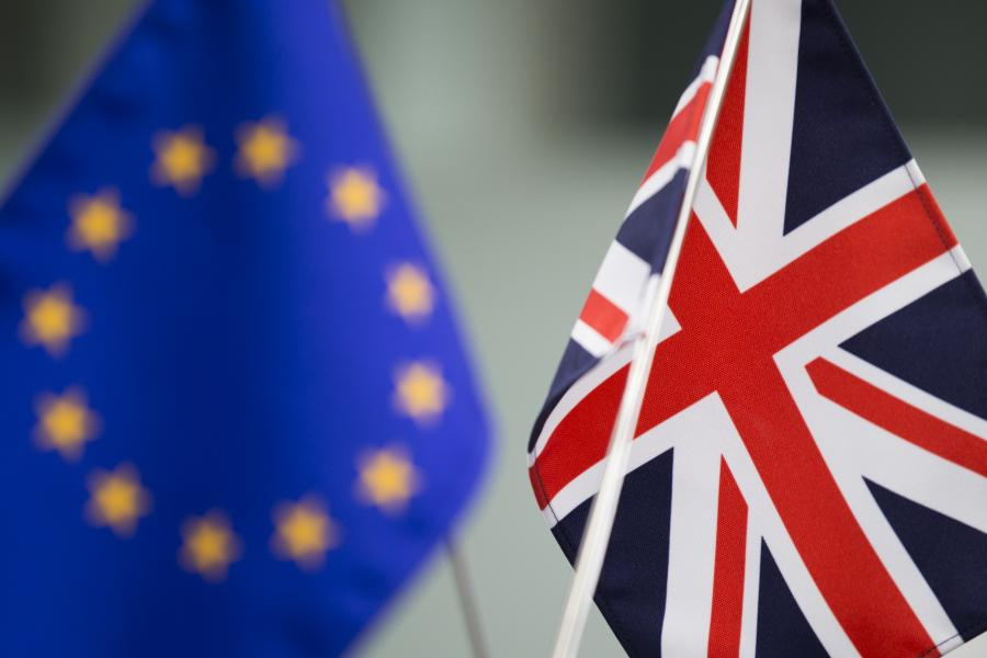 A European Union (EU) flag, left, and a British Union Flag, also know as a Union Jack, stand at a foreign exchange brokerage in Tokyo, Japan.
