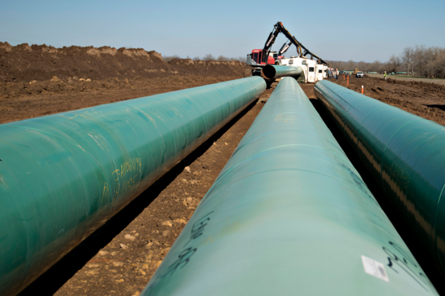 Sections of pipe sit on the ground in Atoka, Oklahoma. Photographer: Daniel Acker/Bloomberg.