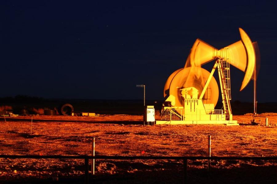 An oil pump jack stands outside of Watford City, North Dakota. Photographer: Matthew Staver/Bloomberg.