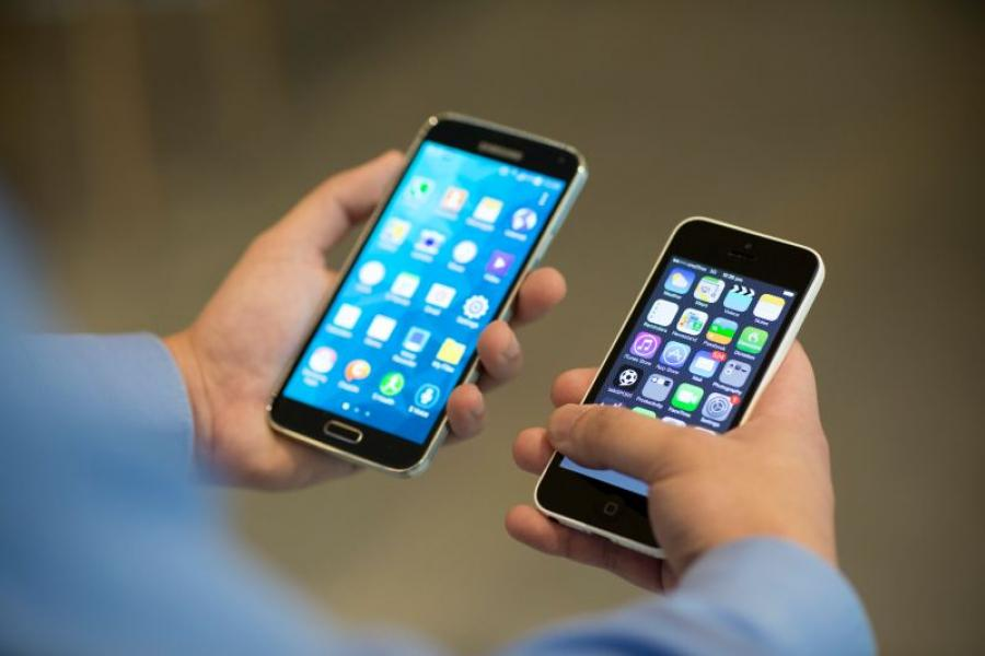 A Samsung Galaxy S5 smartphone, and an Apple iPhone 5c.