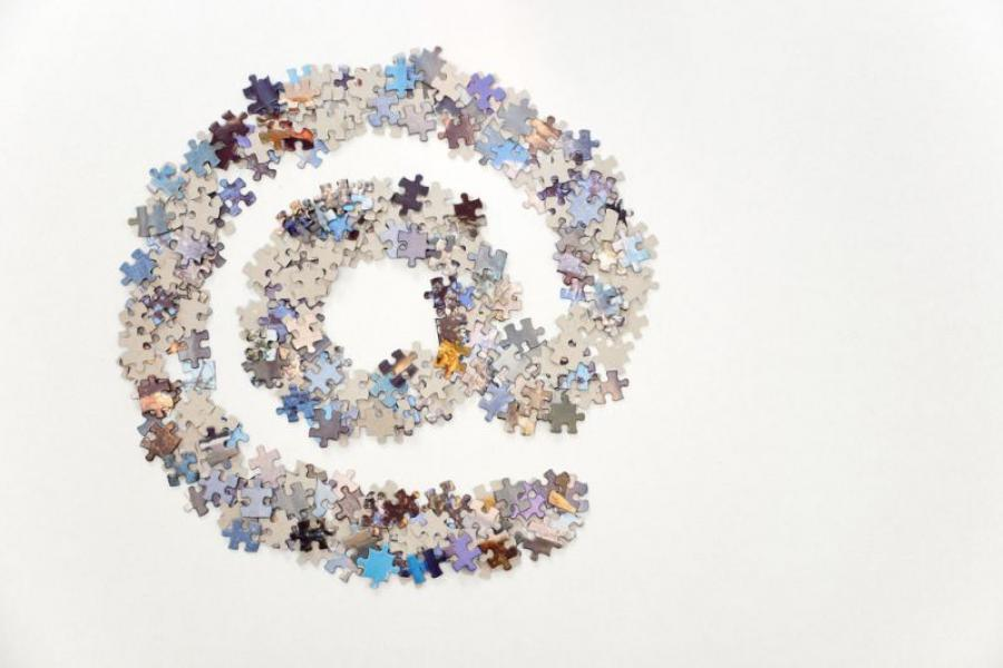"""""""@"""" symbol constructed of puzzle pieces."""