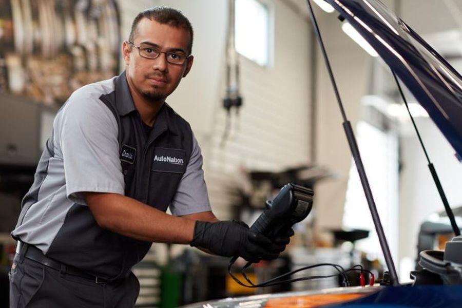 AutoNation car technician working on a car.