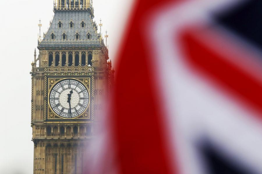 The Union Jack, flies in front of Big Ben, in London, U.K.