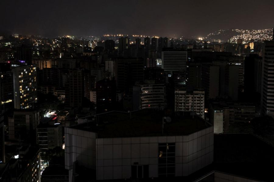 Buildings stand in darkness during a power outage in Caracas, Venezuela.