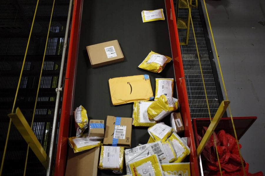 Packages move down a conveyor belt at the DHL Worldwide Express hub at Cincinnati/Northern Kentucky International Airport.