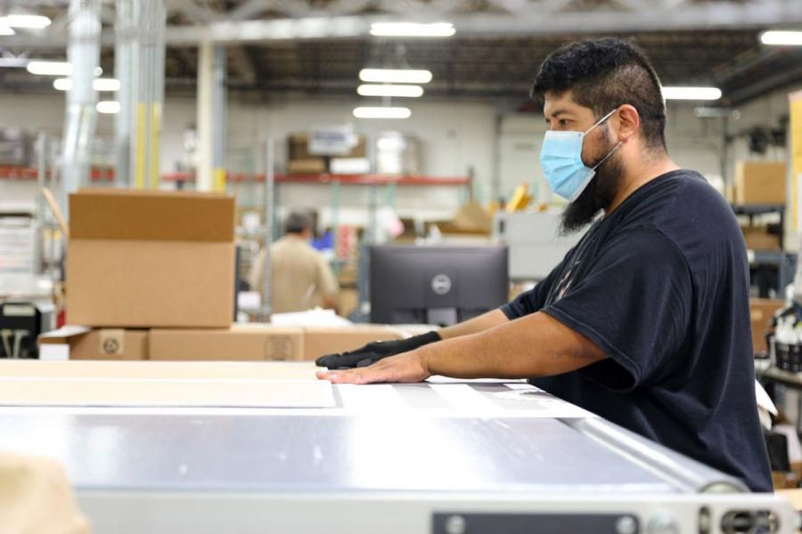 An employee working at the Gifts For You company warehouse in Woodridge, IL.