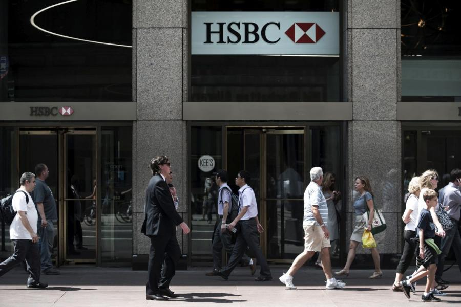 Pedestrians pass in front of a HSBC bank branch in New York City.