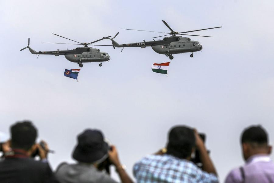 Indian Air Force helicopters carry an Indian national flag during a flypast in Bengaluru, India.