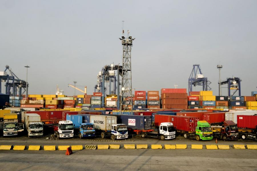 Trucks sit parked at the Manila North Harbour Port.