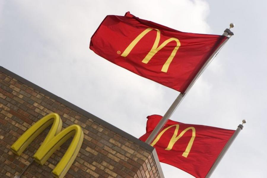 McDonald's flags waving above a store.