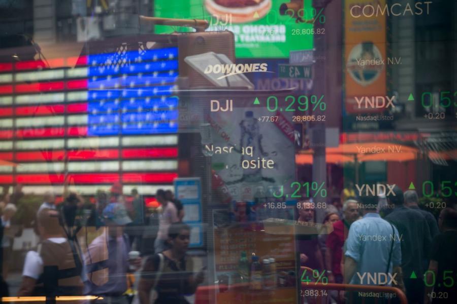 Monitors display stock market information at the Nasdaq MarketSite in New York City.