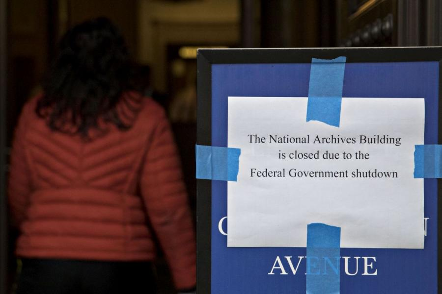 A sign indicating that the National Archives Building in Washington, D.C., is closed due to the federal government shutdown.