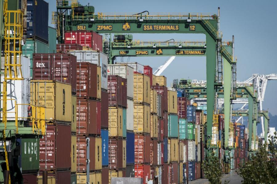 Shipping containers sit stacked at the Port of Oakland in Oakland, CA.
