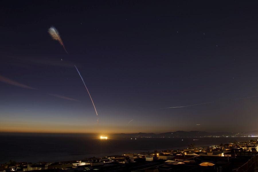 A SpaceX Falcon 9 rocket flies above Manhattan Beach, CA.
