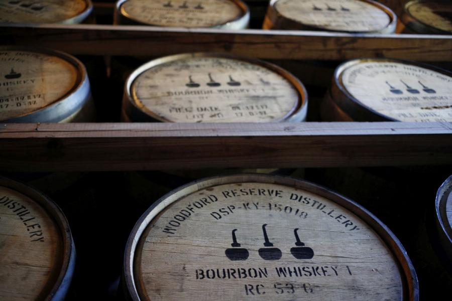 Barrels of bourbon whiskey sit stacked in an aging warehouse in Versailles, KY.
