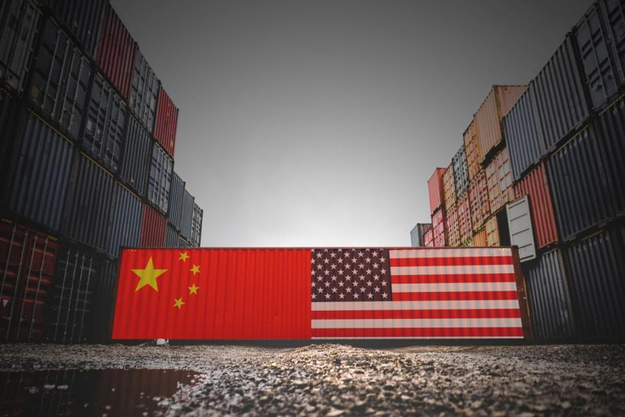 Shipping containers with U.S. and China flags on them.