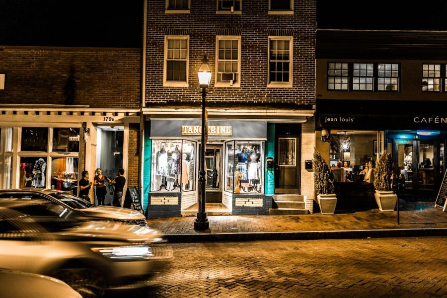 A storefront at night in Annapolis, MD.