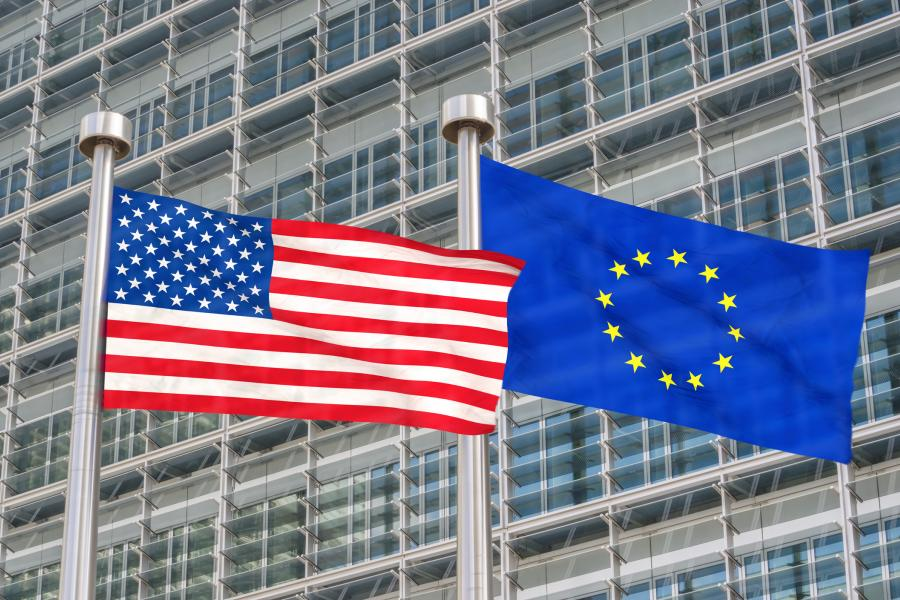 USA and European Union flags waving in the wind