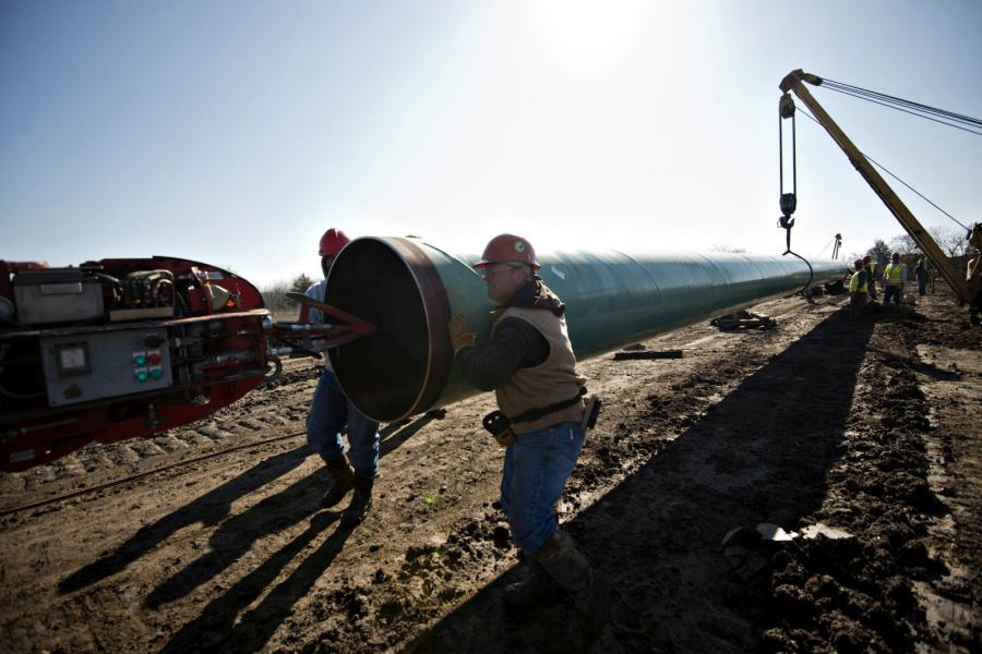 Workers construct part of the Keystone XL pipeline in Atoka, Ok.