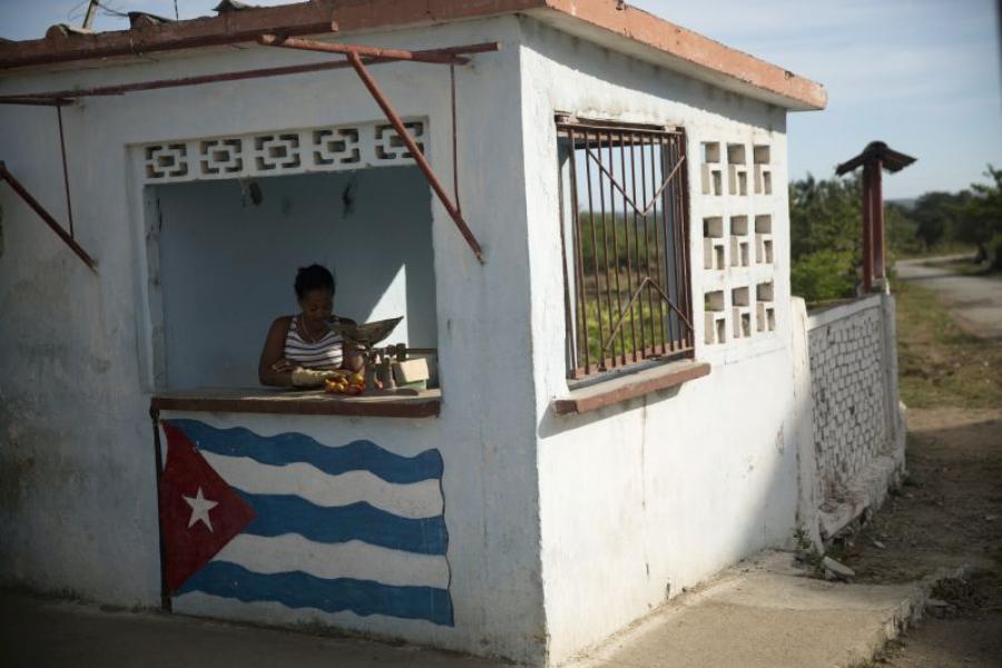 A woman selling tomatoes outside Cienfuegos, Cuba.