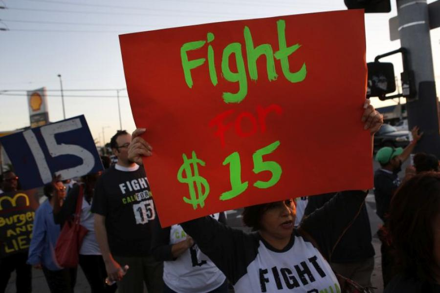 Minimum wage protesters in Los Angeles organized by the SEIU. Photo credit: Patrick T. Fallon/Bloomberg.