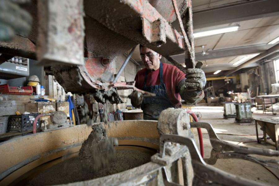 A worker fills a form with concrete at Doty & Sons Concrete Products in Sycamore, Ill.