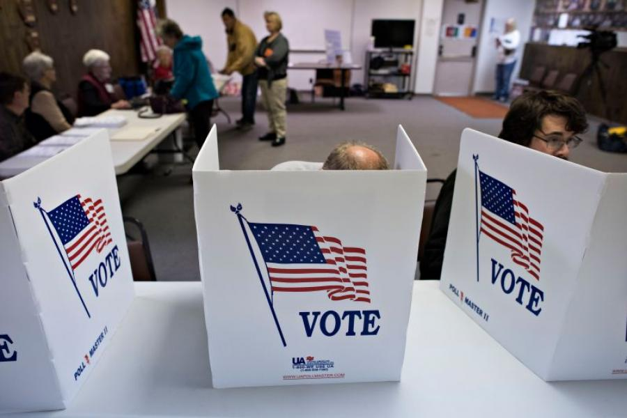 Voters in Iowa cast their ballots in the midterm election.