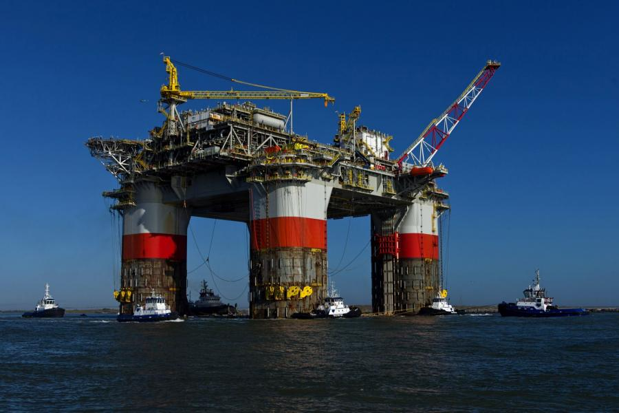 Tug boats move a oil platform to the Gulf of Mexico.