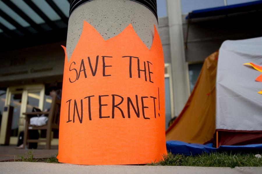 "Orange sign reads, ""Save the Internet."""