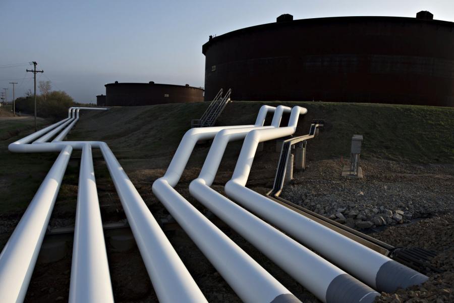 Pipelines run toward oil storage tanks in Cushing, Okla.