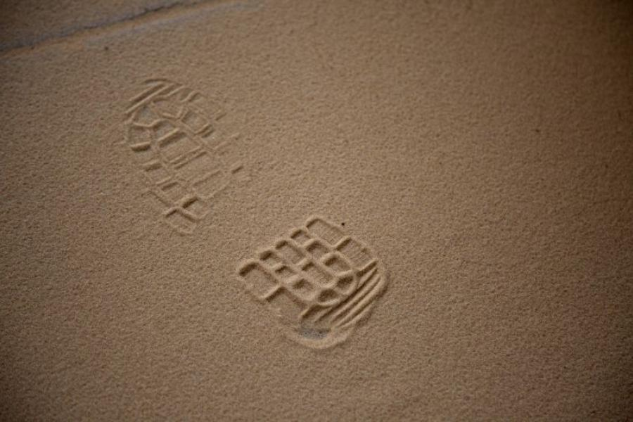 A footprint from a worker's boot is left at a sand mine in Maiden Rock, Wisconsin.