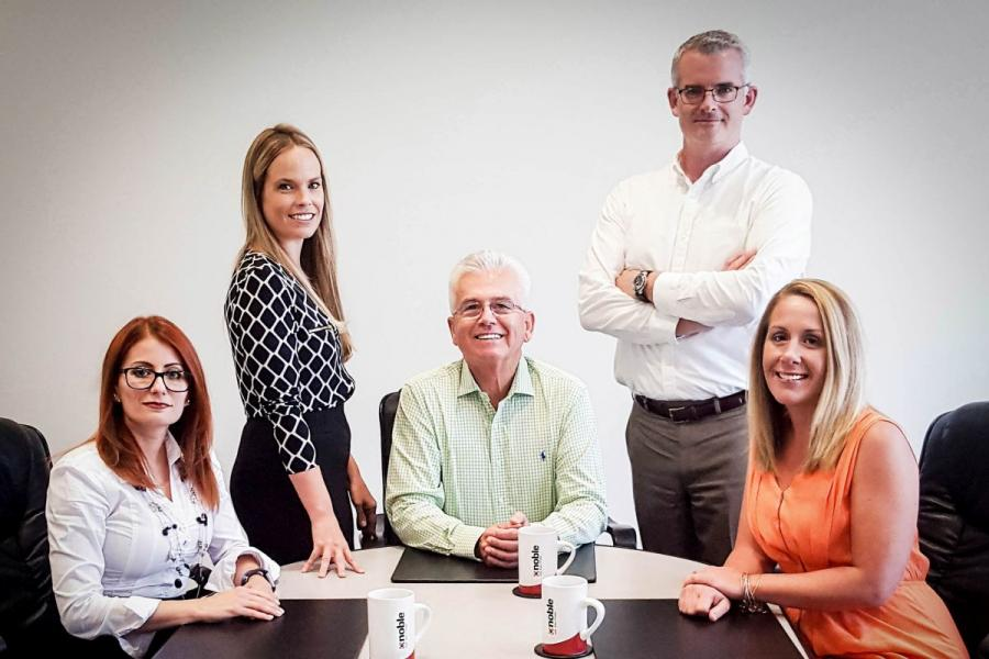 David Mahoney, CEO of Noble Gas Solutions (center), and staff.