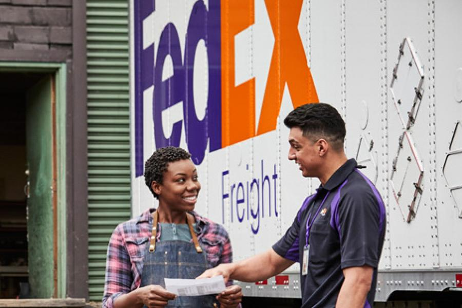 FedEx delivery man and a woman