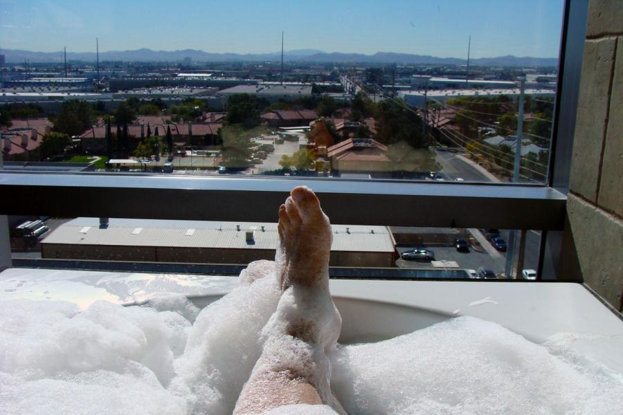 Feet poking out of a bubble bath.