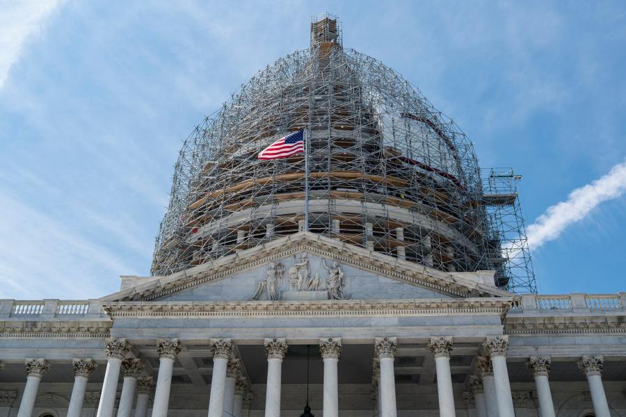 U.S. Capitol dome covered in scaffolding.