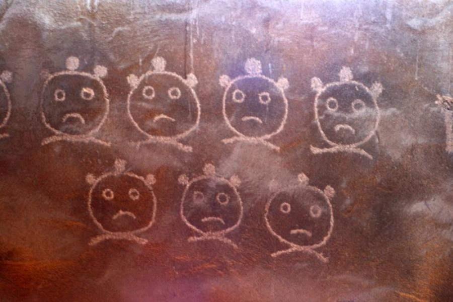 Frown faces in chalk.