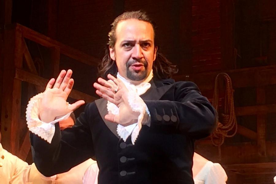 Lin-Manuel Miranda on stage playing Alexander Hamilton.