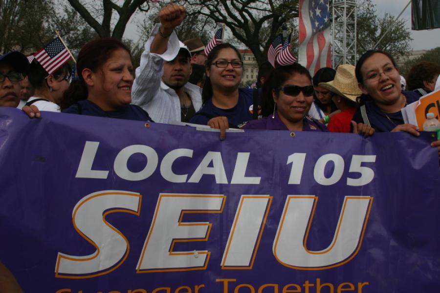 Women holding a Local 105 SEIU banner