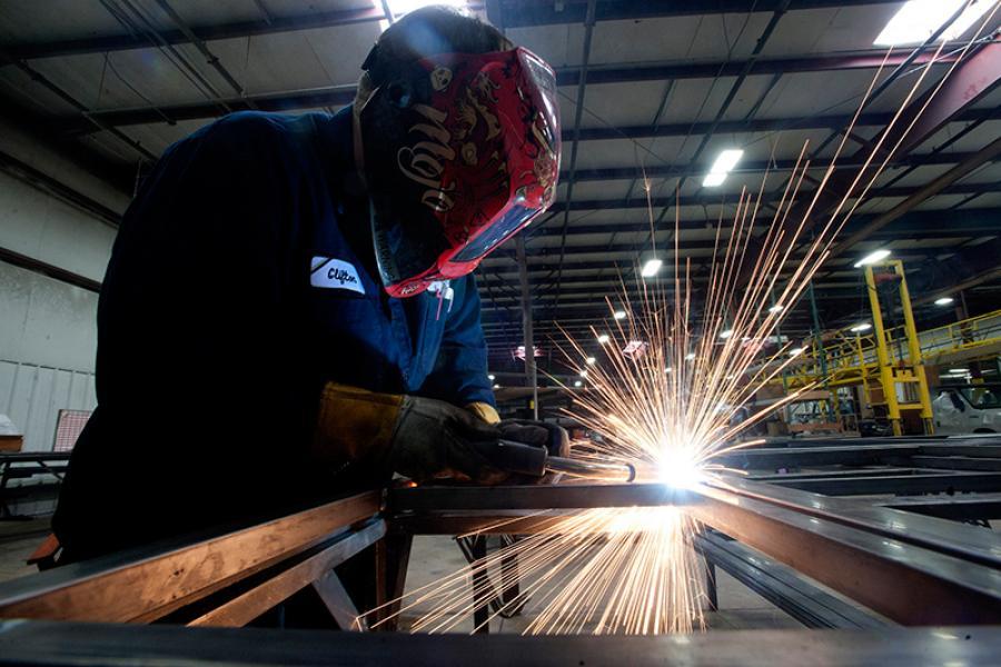 An employee welds steel frames at Nexus RV in Elkhart, IN.