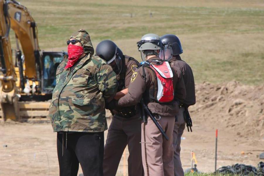 A protester being arrested at a Dakota Access Pipeline construction site near Glen Ullin, N.D.