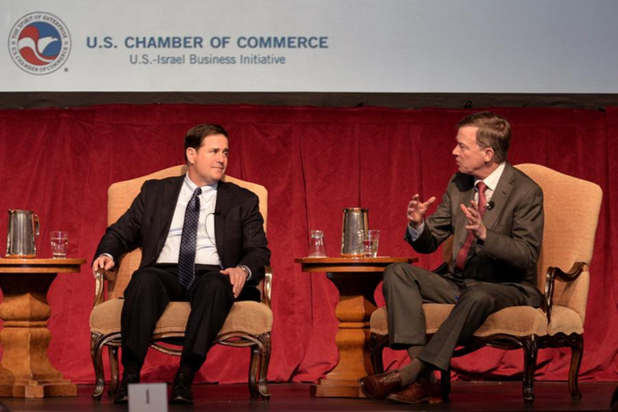Arizona Governor Doug Ducey (left) chats with Colorado Governor John Hickenlooper at the U.S.-Israel Business Initiative's BusinessH2O Summit in Las Vegas, Nev.