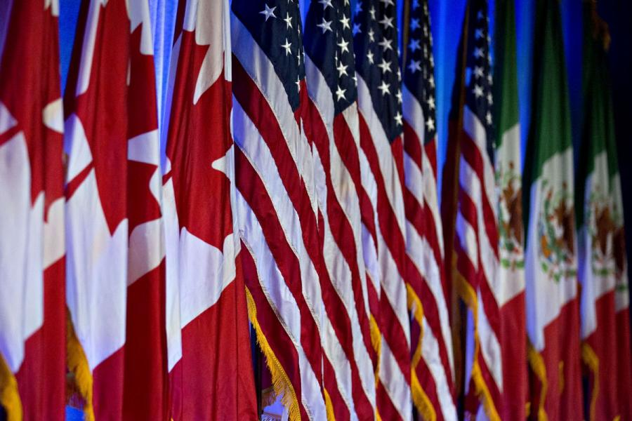 Canadian, American and Mexican flags stand on stage ahead of the first round of North American Free Trade Agreement negotiations in Washington, D.C.