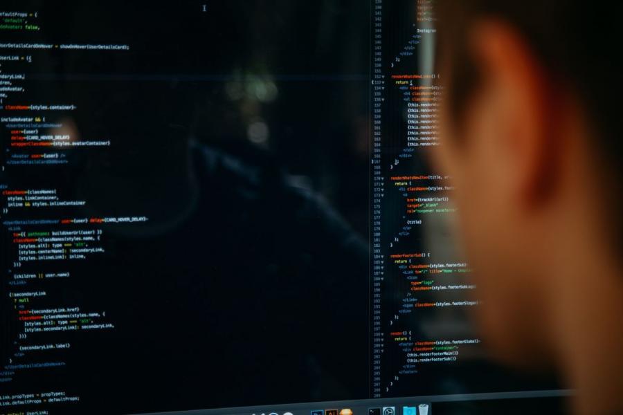 Programmer looking at computer code.