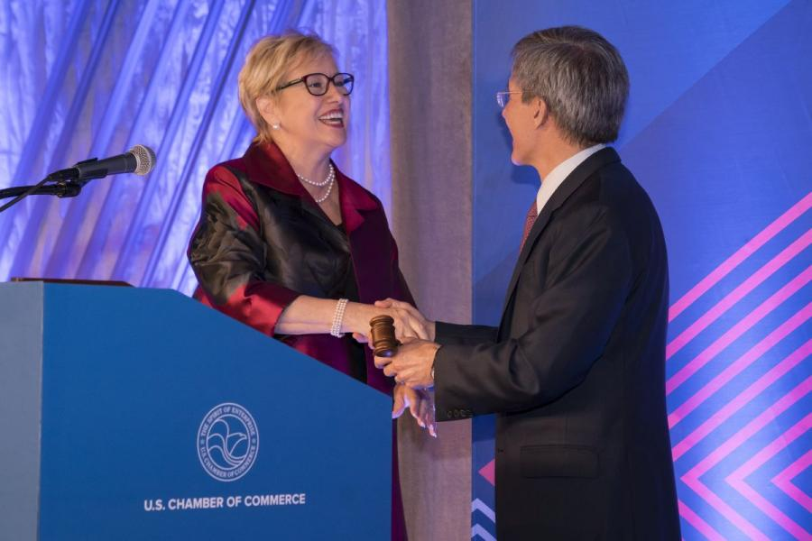 Maura Donahue, left, receives the chairman's gavel from Tom Wilson at the U.S. Chamber of Commerce.