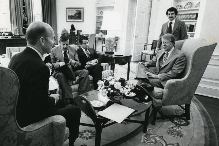 From left, seated: U.S. Chamber of Commerce Chairman-Elect William Eastham, U.S. Chamber President Dr. Richard Lesher, and Board Chairman Herbert Richey meeting with President Jimmy Carter in the Oval Office in February 1977