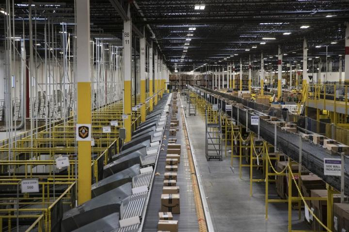 Packages move along conveyer belts at the Amazon.com fulfillment center in Robbinsville, NJ.